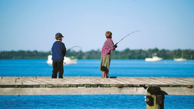 Wild times ... boys fishing off a Caloundra wharf.