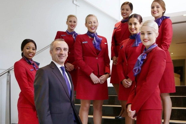 Virgin's 1960s-inspired uniform designed by Juli Grbac. Pictured, Virgin Australia CEO, John Borghetti (second from left).