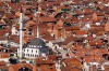 A white mosque between the red houses in the city of Prizren in Kosovo.