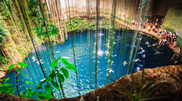Swimming in cenote Ik-Kil, on the Yucatan peninsula, southern Mexico.