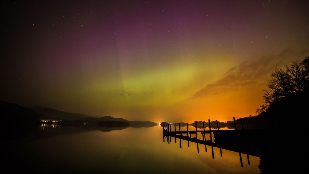 The aurora borealis, or the northern lights, over Derwent water near Keswick, England. The northern lights are the ...