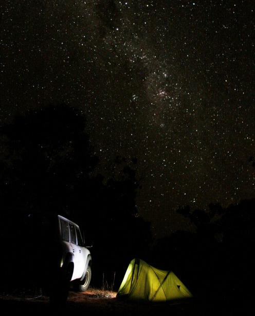 Bush camping under a vivid starry night sky near Cape Leveque, Western Australia.