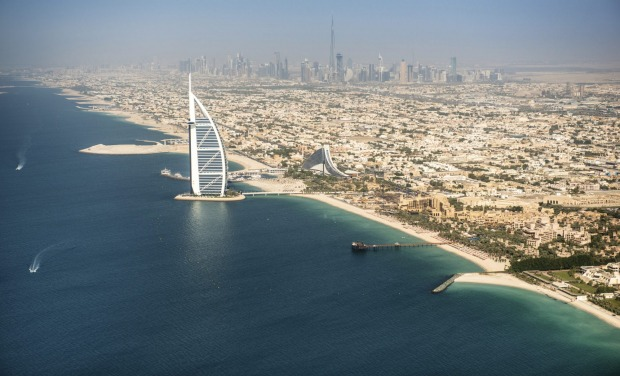 Aerial view of the Dubai coastline with the Burj Al Arab hotel in front of the coastline. Is visible in the background ...