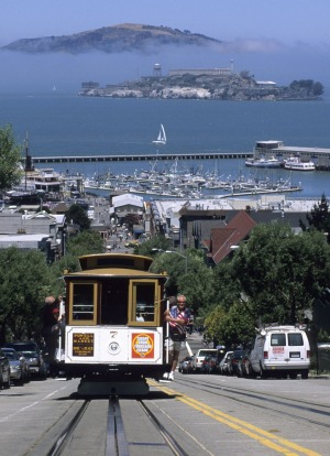 San Francisco's cable car with Alcatraz beyond.