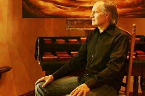 Gentle pace... wood sculptor Yanni Rigos reflects in his gallery.