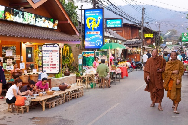 People on the street in the evening in Pai, Thailand: the next Vang Vieng.