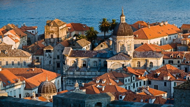 The old town of Dubrovnik set against the sea.