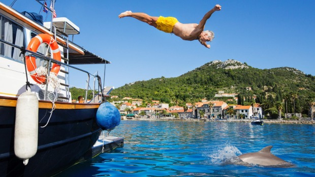 Diving into Dubrovnik's azure waters with dolphins.