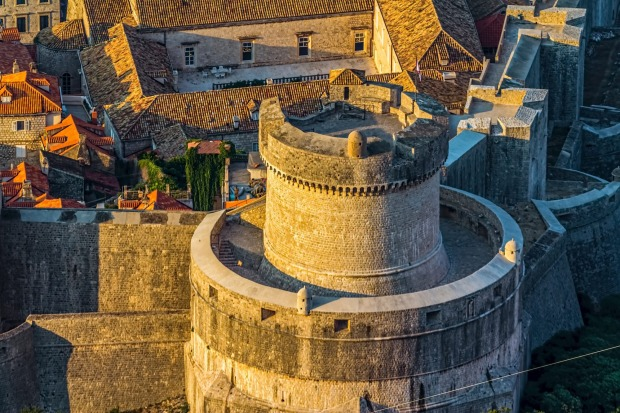 Sunrise over the old town of Dubrovnik's defence walls.