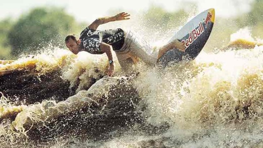 Brazilian Picuruta Salazar surfs a wave on the Amazon River in Amapa in northeastern Brazil in 2003, riding the longest ...