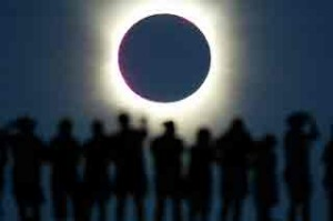 Tourists watch the sun being blocked by the moon during a solar eclipse in the Australian outback town of Lyndhurst in 2002.