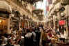 Busy bars and cafes in the interior courtyard of an Ottoman-era building in Istanbul.