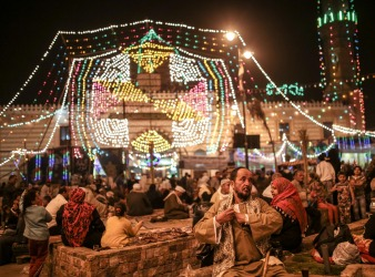 Sufi Muslims take part in a religious festival, or moulid, that celebrates the birth of Sayeda Nafisa, a descendant of the Prophet Muhammad through his grandson Hasan, at the Sayeda Nafisa Mosque, in Cairo, Egypt.