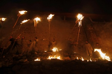 Kashmiri Muslim devotees participate in a torch light procession on a hilltop near the shrine of Muslim saint Sakhi ...