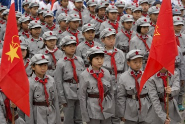 Primary school students in Red Army uniforms visit a Martyrs' Cemetery ahead of the Qingming Festival, or Tomb Sweeping Festival, in Yecheng, Xinjiang Autonomous Region. The Qingming festival is a day for the Chinese to remember and honour their ancestors.