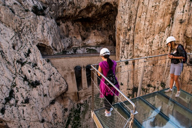 Tourists enjoy the view from the 'El Caminito del Rey' (King's Little Path) footpath on April 1, 2015 in Malaga, Spain. ...