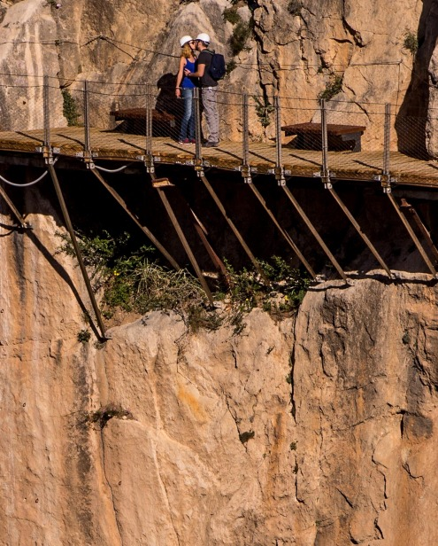 Tourists kiss as they walk along the 'El Caminito del Rey' (King's Little Path) footpath in Malaga, Spain.