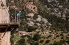 Tourists enjoy the view from the 'El Caminito del Rey' (King's Little Path) footpath in Malaga, Spain.