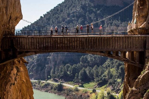 Tourists walk along the 'El Caminito del Rey' (King's Little Path) footpath in Malaga, Spain.