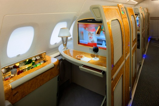 Photos: The Emirates A380 superjumbo first class private suite has a stocked mini-bar at your hand, a wood-grain dining ...