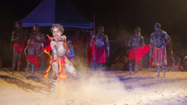 A boy performs with the Red Flag Dancers, a group from the Arnhem Land community of Numbulwarr.
