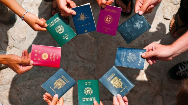 Why is every passport in the world said to feature a varying shade of either red, green, black or blue?