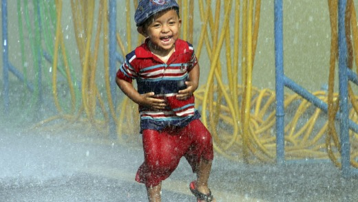 A boy has fun during the opening ceremony of the annual Thingyan water festival celebrations outside Yangon City Hall in ...