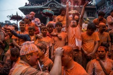 A group of devotees throw vermillion powder to other devotees in celebration of the new year.