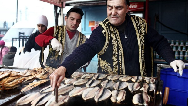 Vendors selling fresh grilled fish in Istanbul.