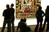 Visitors admire the painting 'Three Women' by French painter Fernand Leger at Berlin's Neue Nationalgalerie.