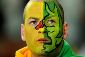 A Wallaby fan has his warpaint on.