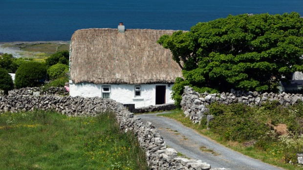 Take your time to tour Ireland and admire the likes of these white-washed, thatched cottage in Galway.