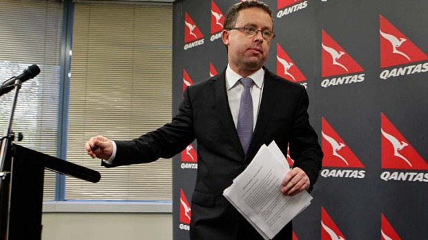 Qantas CEO Alan Joyce leaves a press conference after announcing all flights are grounded immediately due to pressure ...