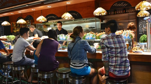 Barcelona: customers seated at a tapas bar at La Boqueria market in Barcelona, Spain.