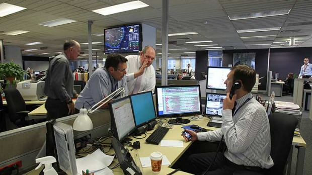 Pushing tin ... The Qantas control room in Sydney works to get flights going.