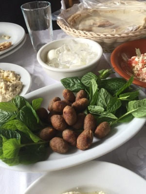 Kibbeh is traditionally  made of ground lamb mixed with spices and burghul cracked wheat.