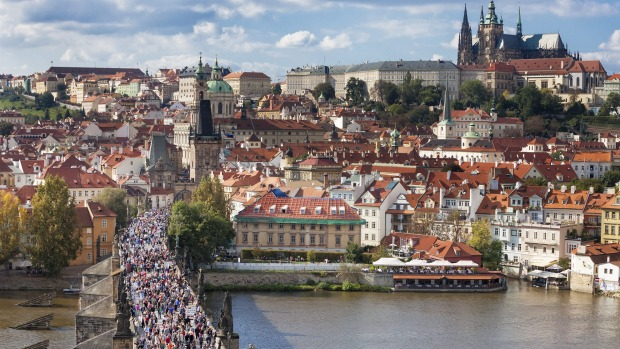 Charles Bridge over the River Vltava is one of Prague's  major tourist attractions.
