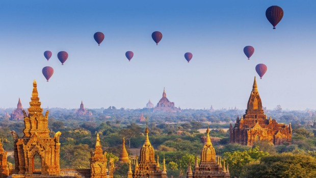 Balloons fly above temples in Bagan, Myanmar.