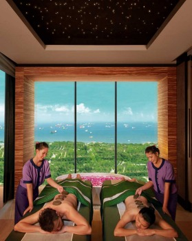 The Banyan Tree Spa offers deluxe massages - complete with an armada of container ships in the background.
