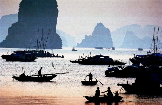 Vietnamese fishermen start their morning fishing in Ha Long bay in northern Quang Ninh province.