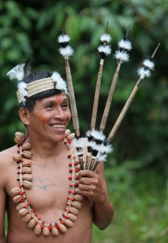 A Waorani indigenous man stands in Yasuni National Park in the Upper Napo Valley of the Western Amazon region in Ecuador,