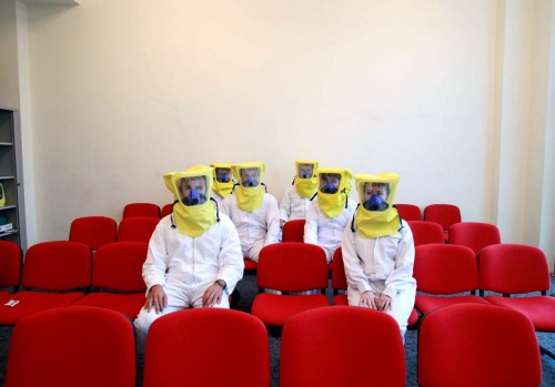 Emirates trainee flight attendants sit in protective clothing during a training session.