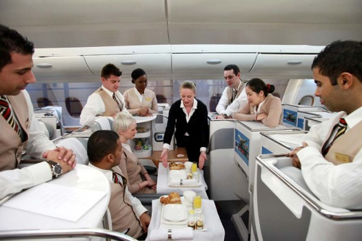 Patricia Walsh, an instructor with Emirates Airline, centre, demonstrates in flight service for business class ...