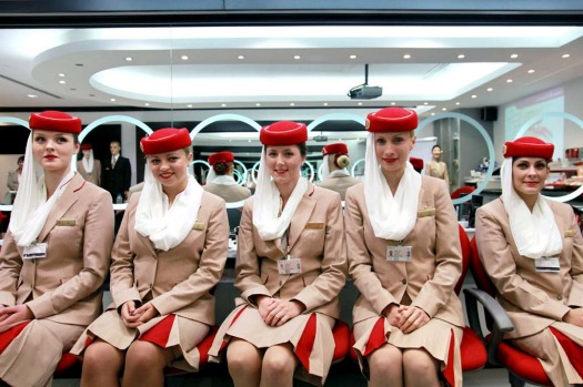 Photos: Inside Emirates' flight attendant school. Flight attendant students for Emirates pose in the image and uniform ...