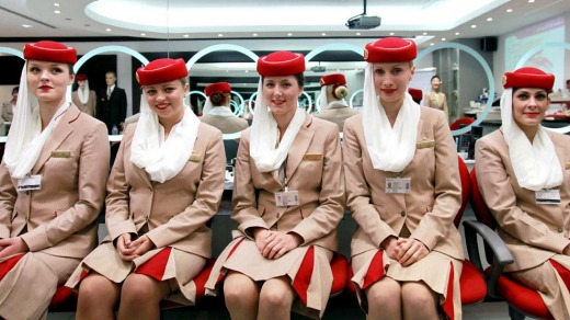 Flight attendant students for Emirates pose in the image and uniform classroom at the Emirates Aviation College in Dubai.