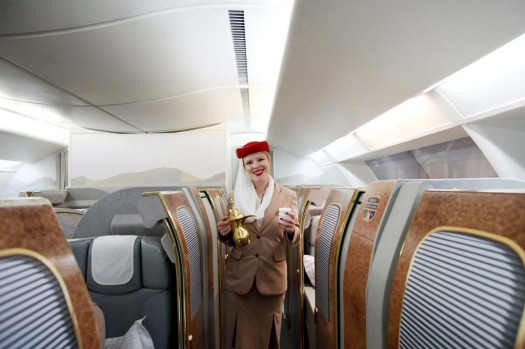 Sherry Wryghte, a training instructor with Emirates Airline, stands in the first class cabin section of the company's ...