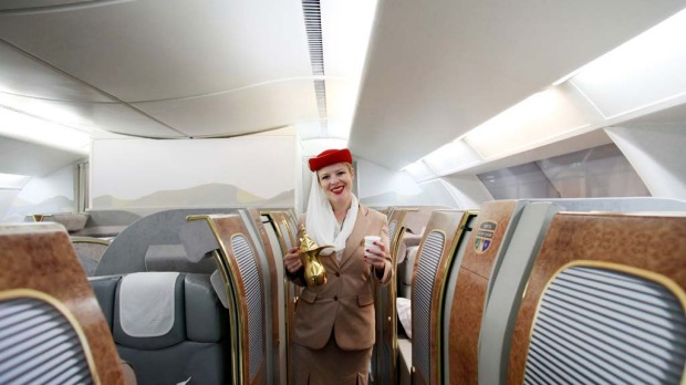 Sherry Wryghte, a training instructor with Emirates Airline, stands in the first class cabin section of the company's training facility at the Emirates Aviation College in Dubai.
