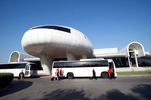 Emirates Airline staff board buses outside the Emirates Aviation College in Dubai.