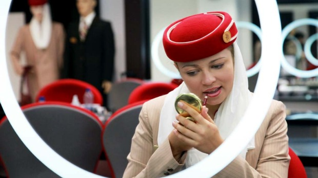 Polina Sasko, an flight attendant student with Emirates, applies lip liner during a make-up training session at the Emirates Aviation College in Dubai.