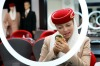 Polina Sasko, an flight attendant student with Emirates, applies lip liner during a make-up training session at the ...